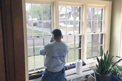 NorthStar employee tinting windows at home in Wichita KS